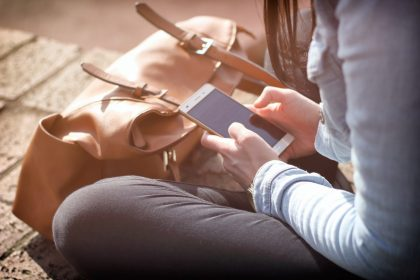 Women looking at at web design on phone